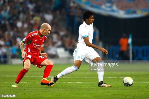 Franck Berrier of Ostende and Luiz Gustavo of Marseille during the UEFA Europa League qualifying match between Marseille and Ostende at Stade...