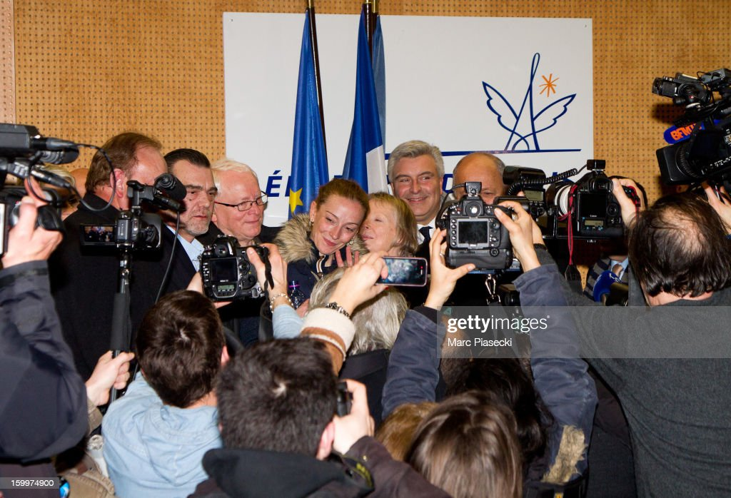 Franck Berton, Bernard Cassez, Florence Cassez, Charlotte Cassez, Marc-Philippe Daubresse and French Foreign Minister Laurent Fabius attend a Press conference following Florence Cassez's release from prison in Mexico at Charles-de-Gaulle airport on January 24, 2013 in Paris, France. A Supreme Court in Mexico voted to free Florence Cassez, 38, from France who was serving out a 60-year sentence for kidnapping. The decision was made after it was decided her rights were violated by a television broadcast of a staged raid on the kidnappers by the police when in fact the alleged kidnappers, including Cassez, were arrested the previous day on a highway.