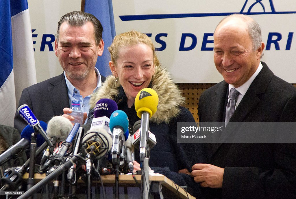 Franck Berton, Florence Cassez and French Foreign Minister Laurent Fabius attend a Press conference following her release from prison in Mexico at Charles-de-Gaulle airport on January 24, 2013 in Paris, France. A Supreme Court in Mexico voted to free Florence Cassez, 38, from France who was serving out a 60-year sentence for kidnapping. The decision was made after it was decided her rights were violated by a television broadcast of a staged raid on the kidnappers by the police when in fact the alleged kidnappers, including Cassez, were arrested the previous day on a highway.