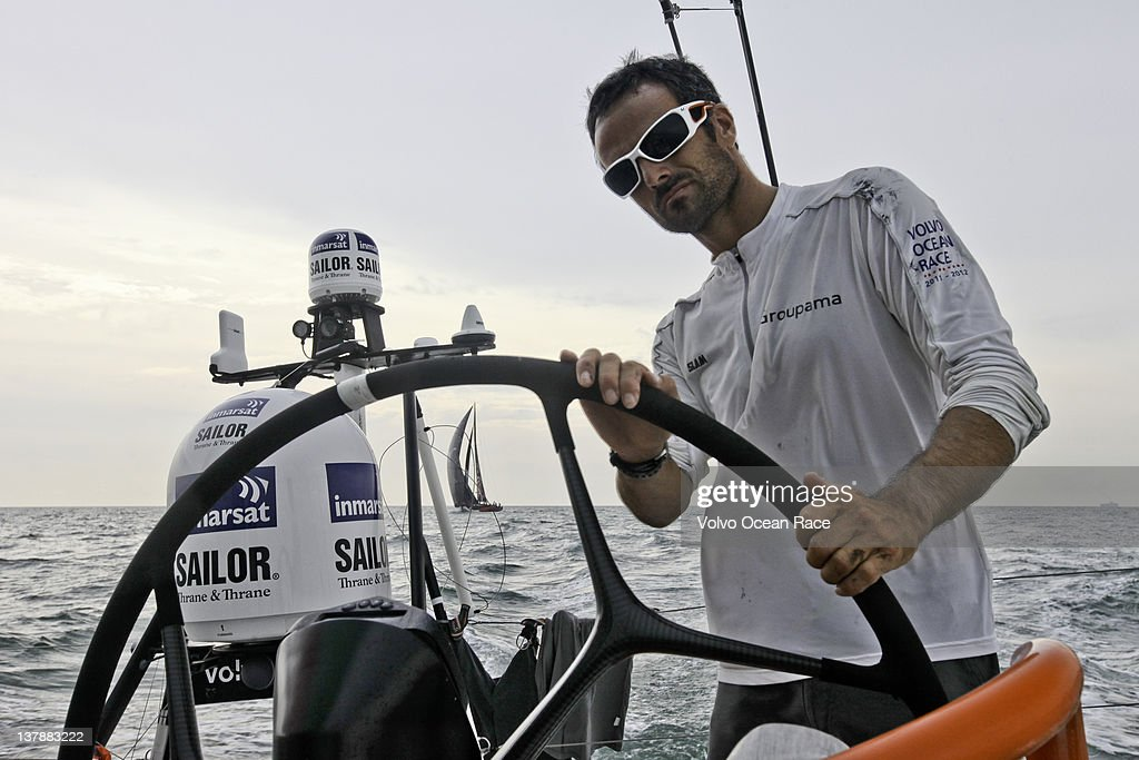 <a gi-track='captionPersonalityLinkClicked' href=/galleries/search?phrase=Franck+Cammas&family=editorial&specificpeople=773410 ng-click='$event.stopPropagation()'>Franck Cammas</a> of France helming Groupama Sailing Team, chased by PUMA Ocean Racing in the Strait of Malacca, during leg 3 of the Volvo Ocean Race 2011-12, January 29, 2012 from Abu Dhabi, UAE to Sanya, China.