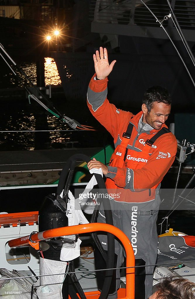 <a gi-track='captionPersonalityLinkClicked' href=/galleries/search?phrase=Franck+Cammas&family=editorial&specificpeople=773410 ng-click='$event.stopPropagation()'>Franck Cammas</a>, Skipper of Groupama waves to friends and family welcoming them to dock after crossing the finish line first during leg 4 of the Volvo Ocean Race on March 10, 2012 in Auckland, New Zealand.