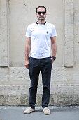 Franck Chabenat is wearing a The Kooples white tshirt Chino Club Monaco black pants Zara shoes a Shanghai Tang watch and Rezin sunglasses during a...