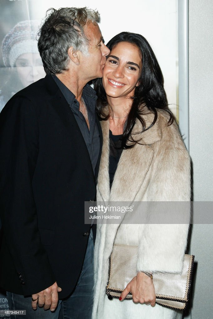 <a gi-track='captionPersonalityLinkClicked' href=/galleries/search?phrase=Franck+Dubosc&family=editorial&specificpeople=609327 ng-click='$event.stopPropagation()'>Franck Dubosc</a> and his wife Daniele attend '24 Jours' Paris Premiere at Publicis Champs Elysees on April 29, 2014 in Paris, France.