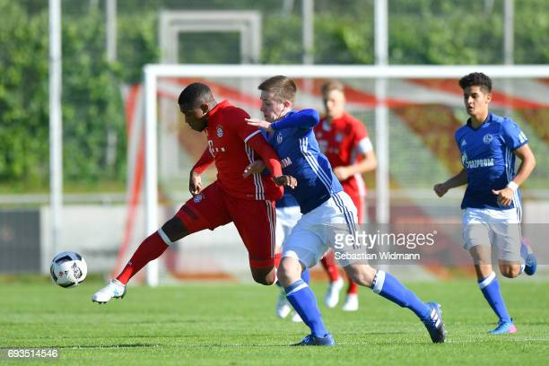 Franck Evina of Bayern Muenchen is being challenged by Jonathan Riemer of Schalke 04 during the B Juniors German Championship Semi Final between...