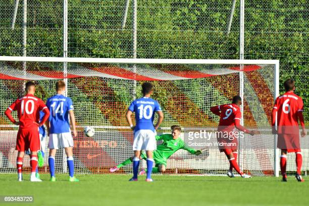 Franck Evina of Bayern Muenchen scores the third goal for his team with a penalty kick during the B Juniors German Championship Semi Final between...