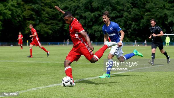 Franck Evina of Bayern runs with the ball during the B Juniors German Championship Semi Final match between FC Schalke and Bayern Muenchen at...