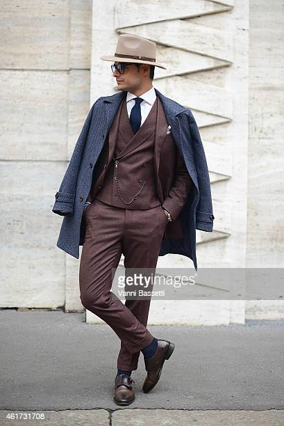 Franck Gallucci poses wearing a Suit Supply suit during day 2 of Milan Menswear Fashion Week Fall/Winter 2015/2016 on January 18 2015 in Milan Italy