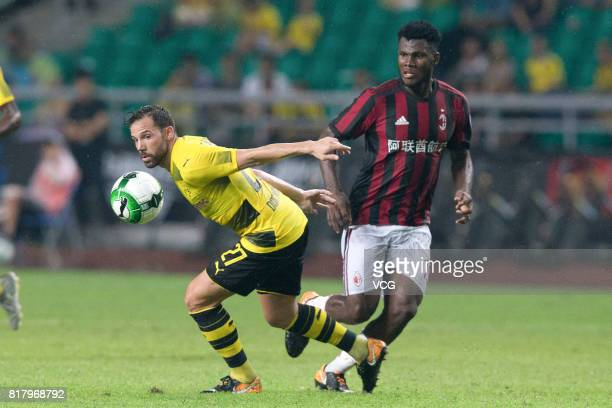 Franck Kessie of AC Milan and Gonzalo Castro of Borussia Dortmund compete for the ball during the 2017 International Champions Cup China between AC...