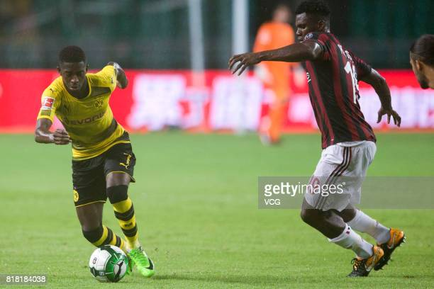 Franck Kessie of AC Milan and Ousmane Dembele of Borussia Dortmund compete for the ball during the 2017 International Champions Cup China between AC...