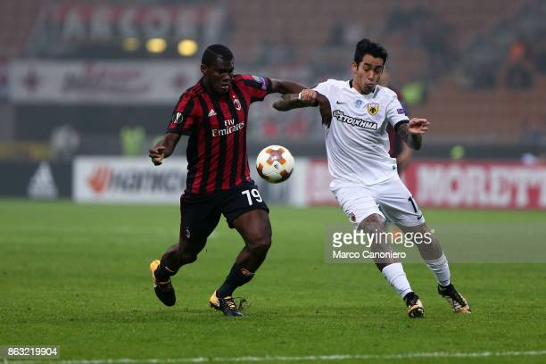 Franck Kessie of Ac Milan and Sergio Araujo of AEK Athens in action during the UEFA Europa League group D football match between AC Milan and AEK...