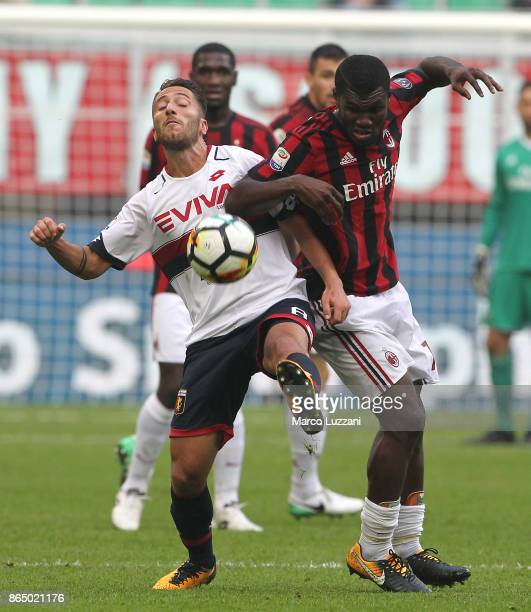 Franck Kessie of AC Milan competes for the ball with Andrea Bertolacci of Genoa CFC during the Serie A match between AC Milan and Genoa CFC at Stadio...