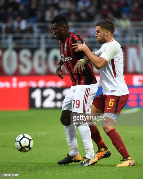 Franck Kessie of AC Milan competes for the ball with Kevin Strootman of AS Roma during the Serie A 2017/18 match between AC Milan and AS Roma at...