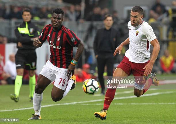 Franck Kessie of AC Milan competes for the ball with Kevin Strootman of AS Roma during the Serie A match between AC Milan and AS Roma at Stadio...