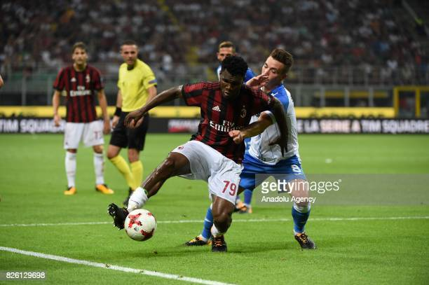 Franck Kessie of AC Milan in action against Alexandru Mateiu of CS U Craiova during UEFA Europa League Qualifying Round match between AC Milan and CS...