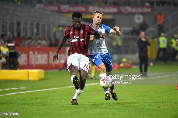 Franck Kessie of AC Milan in action against Nicusor Bancu of CS U Craiova during UEFA Europa League Qualifying Round match between AC Milan and CS U...
