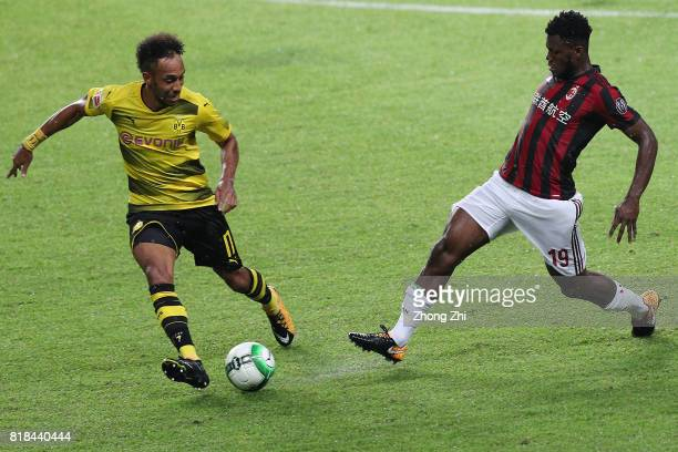 Franck Kessie of AC Milan in action against PierreEmerick Aubameyang of Dortmund during the 2017 International Champions Cup football match between...
