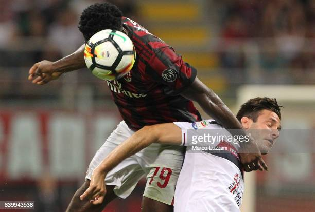 Franck Kessie of AC Milan is challenged by Duje Cop of Cagliari Calcio during the Serie A match between AC Milan and Cagliari Calcio at Stadio...