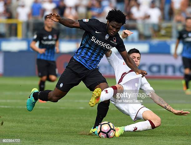 Franck Kessie of Atalanta BC competes for the ball with Daniele Baselli of FC Torino during the Serie A match between Atalanta BC and FC Torino at...