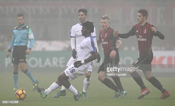 Franck Kessie of Atalanta BC is challenged by Mario Pasalic of AC Milan during the Serie A match between AC Milan and Atalanta BC at Stadio Giuseppe...