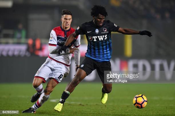 Franck Kessie of Atalantais is challenged by Lorenzo Crisetig of Crotone during the Serie A match between Atalanta BC and FC Crotone at Stadio Atleti...