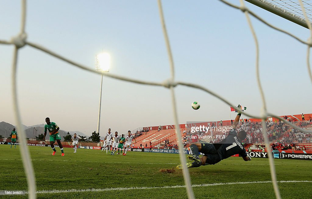 Franck Kessie of Ivory Coast scores a penalty during the Round of 16 match of the FIFA U-17 World Cup between Morocco and Ivory Coast at Fujairah Stadium on October 29, 2013 in Fujairah, United Arab Emirates.