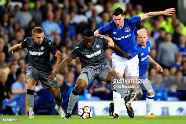 Franck Ohandza Zoa of Hajduk Split holds off Michael Keane of Everton during the UEFA Europa League Qualifying PlayOffs round first leg match between...