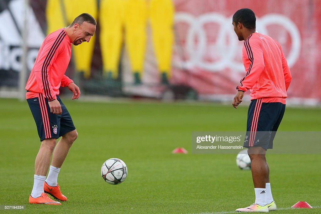 Franck Ribery and Douglas Costa in action during a FC Bayern Muenchen training session ahead of their UEFA Champions League semi final second leg match against Club Atletico de Madrid at the Saebener Strasse training ground on May 2, 2016 in Munich, Germany.
