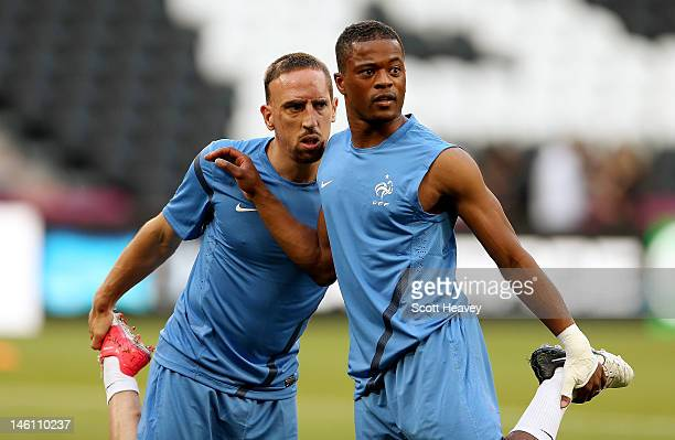 Franck Ribery and Patrice Evra of France during a UEFA EURO 2012 training session at the Donbass Arena on June 10 2012 in Donetsk Ukraine