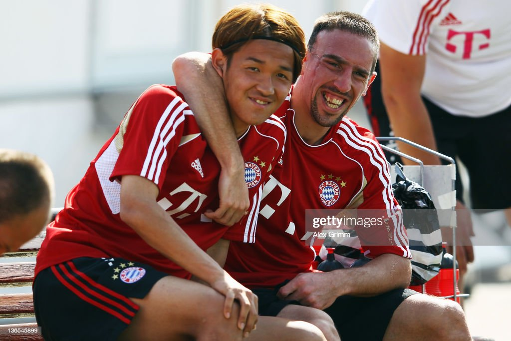 Franck Ribery (R) and Takashi Usami have fun during a training session of Bayern Muenchen at the ASPIRE Academy for Sports Excellence on January 8, 2012 in Doha, Qatar.