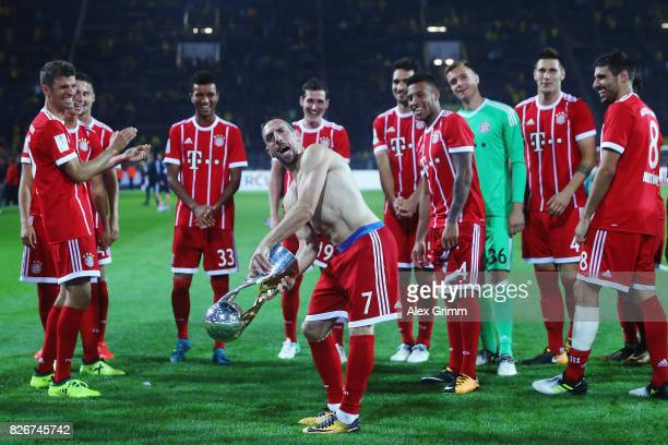 Franck Ribery and team mates of Muenchen celebrate with the trophy after his team won the DFL Supercup 2017 match between Borussia Dortmund and...