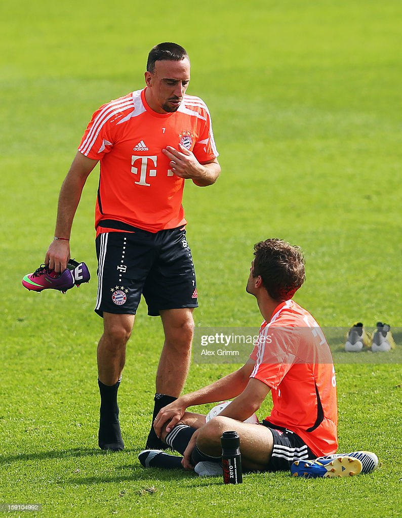 Franck Ribery discusses with Thomas Mueller during a Bayern Muenchen training session at the ASPIRE Academy for Sports Excellence on January 8, 2013 in Doha, Qatar.