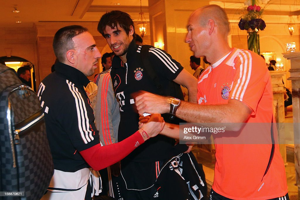 <a gi-track='captionPersonalityLinkClicked' href=/galleries/search?phrase=Franck+Ribery&family=editorial&specificpeople=490869 ng-click='$event.stopPropagation()'>Franck Ribery</a>, Javier Martinez and <a gi-track='captionPersonalityLinkClicked' href=/galleries/search?phrase=Arjen+Robben&family=editorial&specificpeople=194740 ng-click='$event.stopPropagation()'>Arjen Robben</a> (L-R) arrive at the Grand Heritage Hotel on day 1 of the Bayern Muenchen training camp on January 2, 2013 in Doha, Qatar.