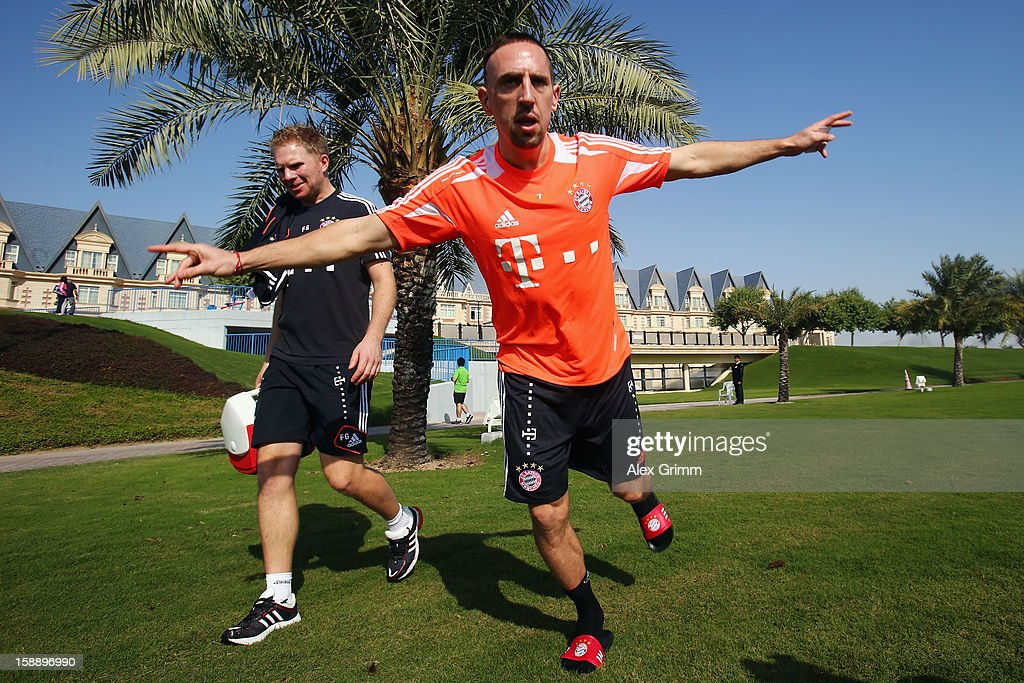 Franck Ribery jumps on his way to a Bayern Muenchen training session at the ASPIRE Academy for Sports Excellence on January 3, 2013 in Doha, Qatar.