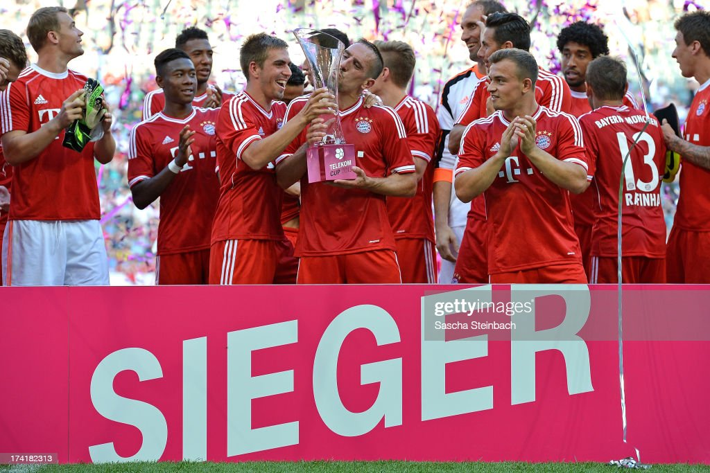 <a gi-track='captionPersonalityLinkClicked' href=/galleries/search?phrase=Franck+Ribery&family=editorial&specificpeople=490869 ng-click='$event.stopPropagation()'>Franck Ribery</a> (C) kisses the trophy winning the Telekom Cup 2013 final match between Borussia Moenchengladbach and FC Bayern Muenchen at Borussia-Park on July 21, 2013 in Moenchengladbach, Germany.