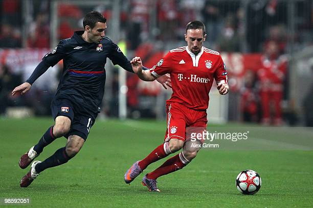 Franck Ribery of Bayern and Anthony Reveillere of Lyon battle for the ball during the UEFA Champions League semi final first leg match between FC...