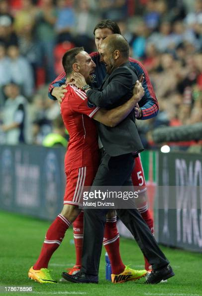 Franck Ribery of Bayern celebrates his goal with head coach Josep Guardiola celebrates his goal during the UEFA Super Cup match between FC Bayern...