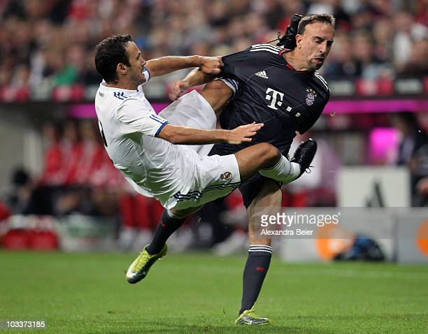Franck Ribery of Bayern Muenchen and Ricardo Carvalho of Real Madrid fall after they fighted for the ball during the Franz Beckenbauer Farewell match...