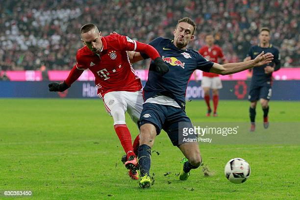Franck Ribery of Bayern Muenchen and Stefan Ilsanker of RB Leipzig battle for possession during the Bundesliga match between Bayern Muenchen and RB...