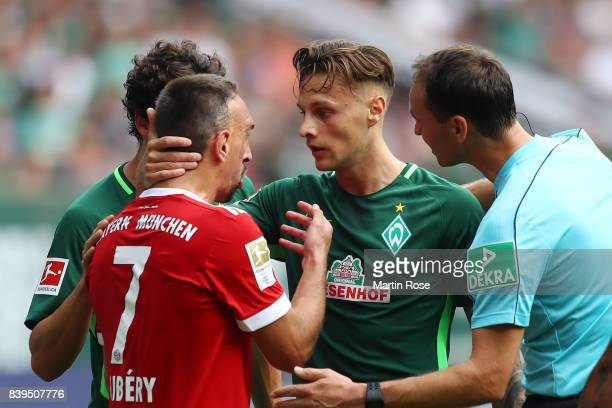Franck Ribery of Bayern Muenchen argues with Robert Bauer of Bremen during the Bundesliga match between SV Werder Bremen and FC Bayern Muenchen at...