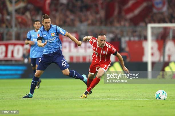 Franck Ribery of Bayern Muenchen battles for the ball with Dominik Kohr of Leverkusen during the Bundesliga match between FC Bayern Muenchen and...