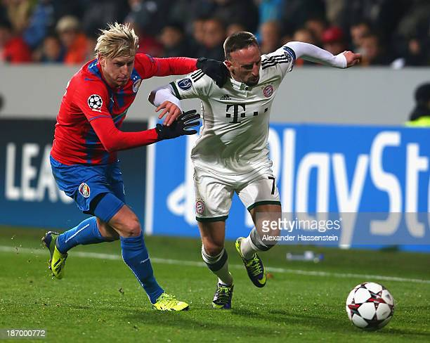 Franck Ribery of Bayern Muenchen battles for the ball with Frantisek Rajtoral of Plzen and his team mate Vaclav Prochazka during the UEFA Champions...
