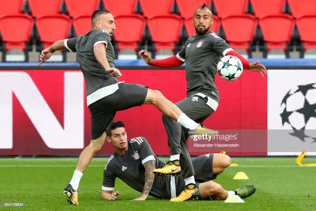 Franck Ribery (L) of Bayern Muenchen battles for the ball with his team mates James Rodriquez and Arturo Vidal during a training session ahead of the UEFA Champions League Group B match against Paris Saint Germain (PSG) at Parc des Princes on September 26, 2017 in Paris, France.
