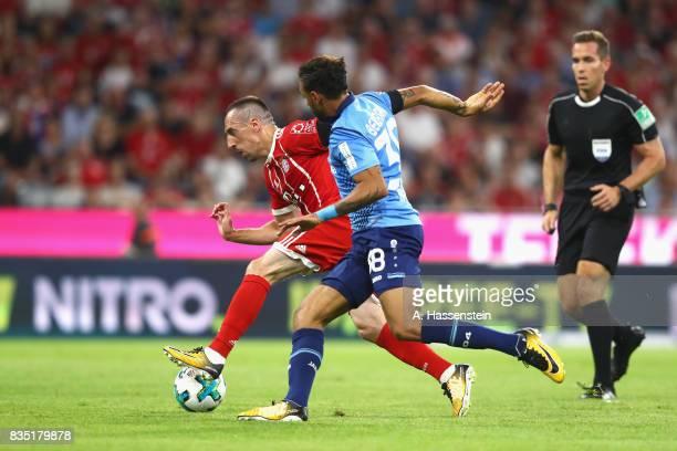 Franck Ribery of Bayern Muenchen battles for the ball with Karim Bellarabi of Leverkusen during the Bundesliga match between FC Bayern Muenchen and...