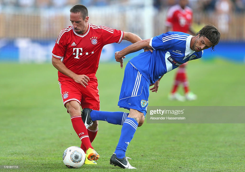 Franck Ribery of Bayern Muenchen battles for the ball with Massimo Paci (R) of Brescia during the friendly match between Brescia Calcio and FC Bayern Muenchen at Campo Sportivo on July 9, 2013 in Arco, Italy.