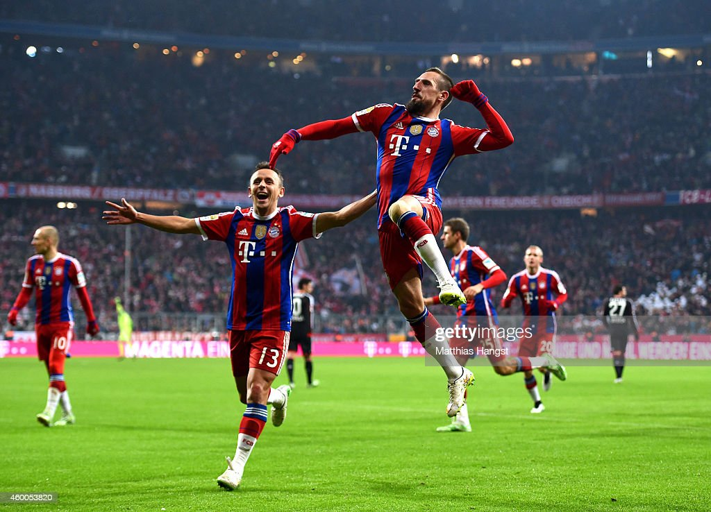 Franck Ribery of Bayern Muenchen celebrates after scoring the opening goal during the Bundesliga match between FC Bayern Muenchen and Bayer 04 Leverkusen at the Allianz Arena on December 6, 2014 in Munich, Germany.
