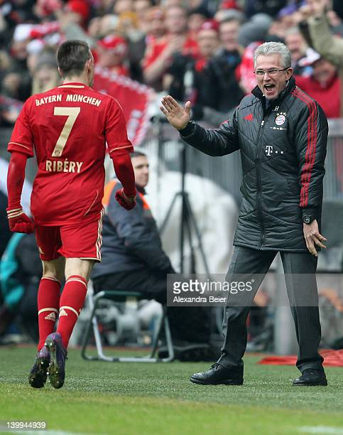 Franck Ribery of Bayern Muenchen celebrates his first goal together with team coach Jupp Heynckes during the Bundesliga match between FC Bayern...