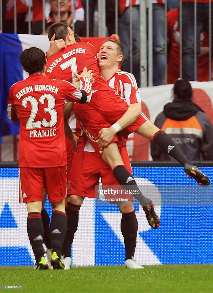 Franck Ribery (C) of Bayern Muenchen celebrates his second goal with his teammates Danijel Pranjic (L) and Bastian Schweinsteiger during the Bundesliga match between 1. FC Muenchen and Hamburger SV at Allianz Arena on March 12, 2011 in Munich, Germany.
