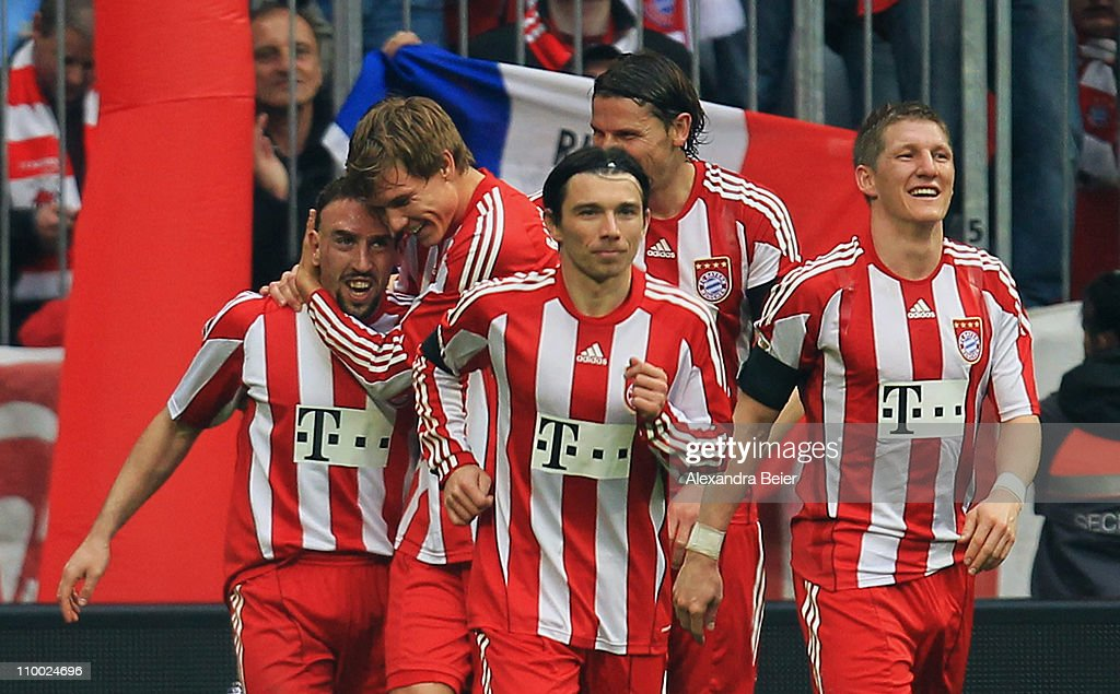 Franck Ribery of Bayern Muenchen celebrates his second goal with his teammates Holger Badstuber, Danijel Pranjic, Daniel van Buyten and Bastian Schweinsteiger (2nd L-R) and Bastian Schweinsteiger during the Bundesliga match between 1. FC Muenchen and Hamburger SV at Allianz Arena on March 12, 2011 in Munich, Germany.