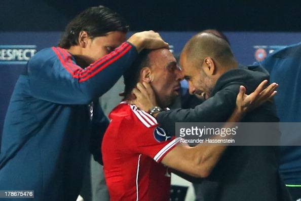 Franck Ribery of Bayern Muenchen celebrates scoring his first goal with his head coach Pep Guardiola and team mate Daniel Van Buyten during the UEFA...
