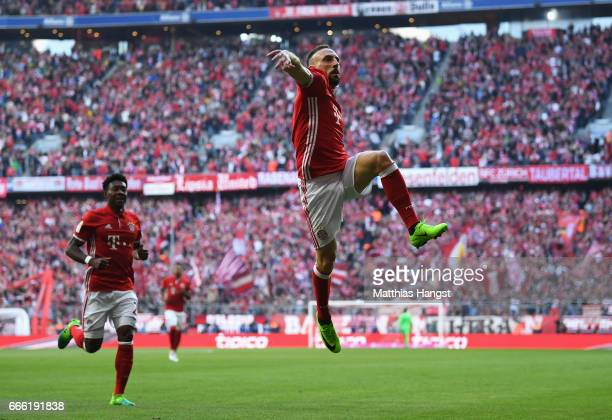 Franck Ribery of Bayern Muenchen celebrates scoring his sides first goal during the Bundesliga match between Bayern Muenchen and Borussia Dortmund at...